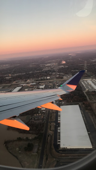 an airplane wing over a city