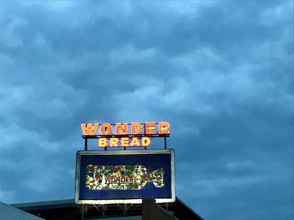 an older billboard for Wonder Bread against a blue sky