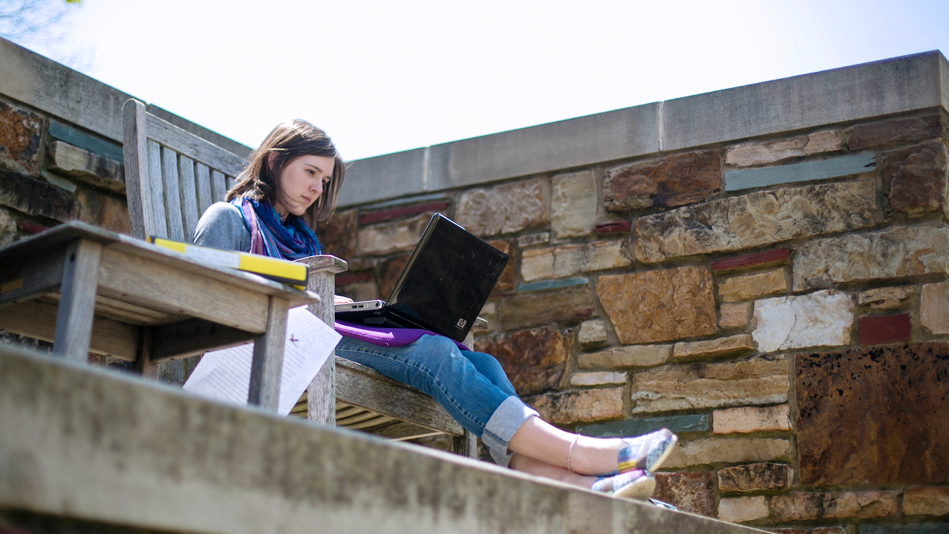 Student with a laptop on campus