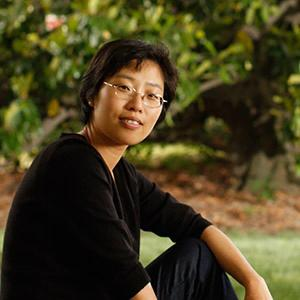 an Asian woman with glasses and short hair